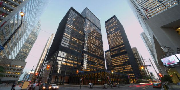Corner of Bay Street and King Street at dusk in the Financial District of Toronto at
