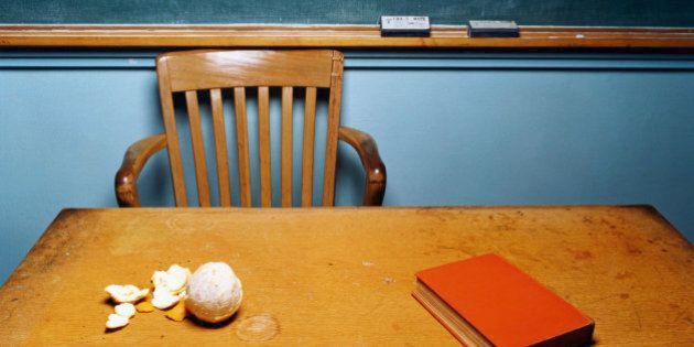 Teacher's desk with peeled orange on