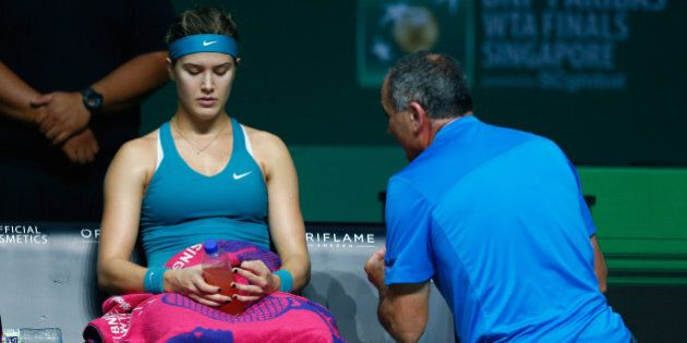 SINGAPORE - OCTOBER 22: Eugenie Bouchard of Canada receives coaching from Nick Saviano in her match against...