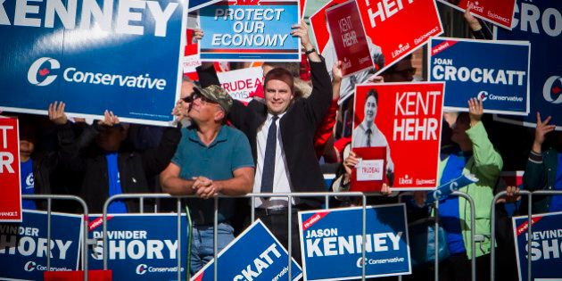 Attendees holds signs in support of different candidates ahead of the second leaders' debate in Calgary,...