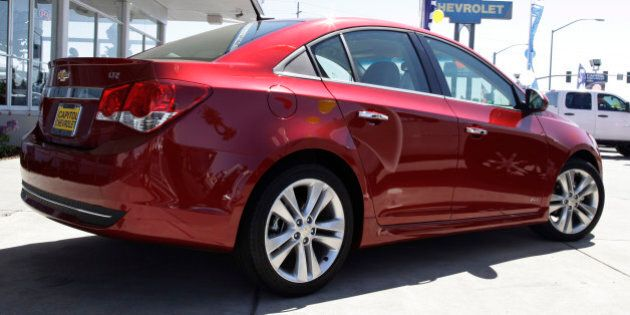 In this Aug. 30, 2011 photo a 2011 Chevrolet Cruze is displayed at a car dealership in San Jose, Calif....