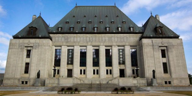 The Supreme Court of Canada stands in Ottawa, Ontario, Canada, on Wednesday, Aug. 10, 2011. Canada's trade deficit widened more than forecast in June, signaling that the economy may have stalled or even contracted in the second quarter. Photographer: Brent Lewin/Bloomberg via Getty Images
