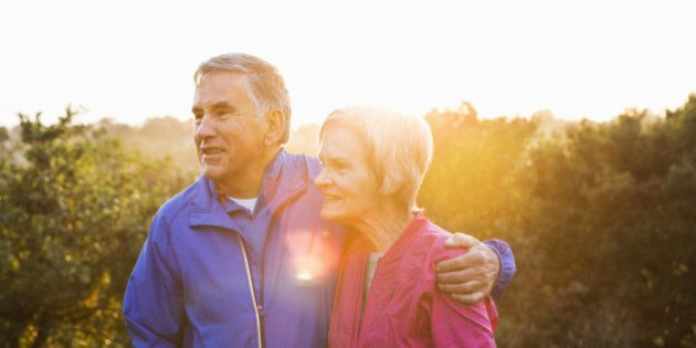 Portrait of senior couple in running gear