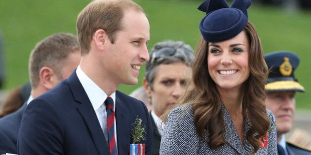 Britain's Prince William and his wife Kate, the Duchess of Cambridge, chat during the Anzac Day parade...