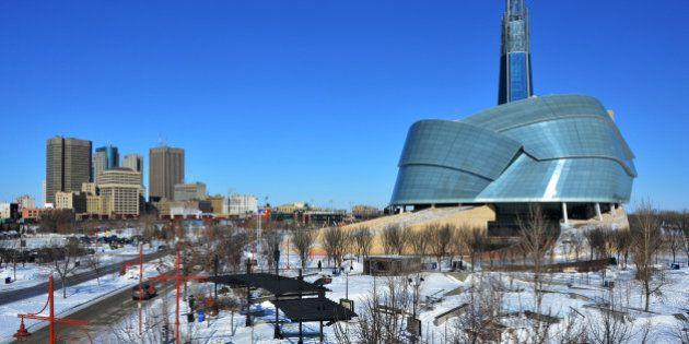 An urban cityscape of downtown Winnipeg, Manitoba under a big blue sky.