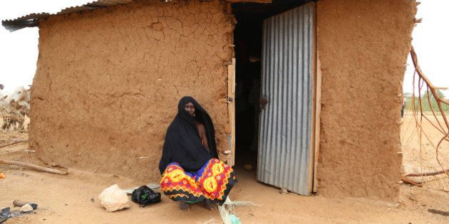 DADAAB, KENYA - OCTOBER 12: This photo taken on October 4, 2014 shows a refugee woman crouching in front...