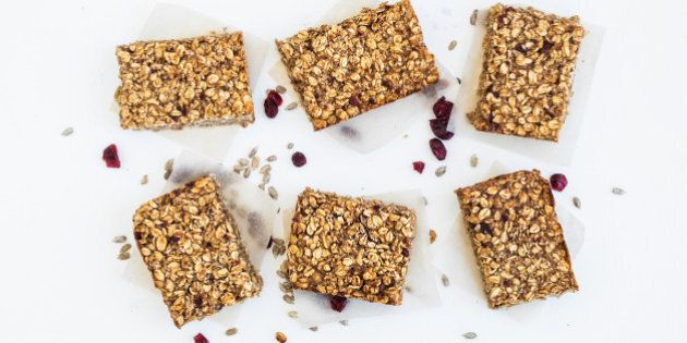 Healthy oat granola bars on white background, top