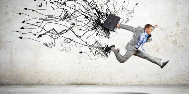 Image of businessman in jump against sketch