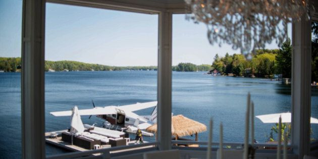A float plane sits docked outside of a cottage on Lake Jo in Muskoka, Ontario, Canada, on Saturday, May...