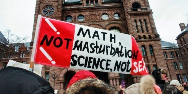 TORONTO, ON - FEBRUARY 24: Protesters rally against Ontario's new sex education curriculum outside Queen's...