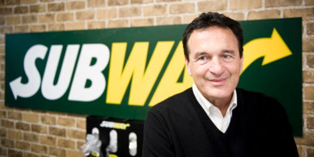 Fred DeLuca, President and founder of sandwich maker Subway, smiles during an interview in a Subway restaurant...