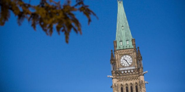 OTTAWA, ON - OCTOBER 23: The flag atop the Main Parliament Building is flown at half staff one day after...