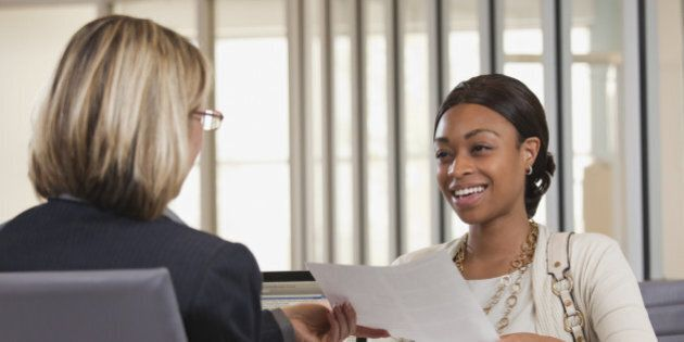 Businesswoman handing paper to
