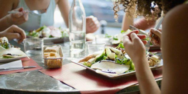 Friends enjoying meal in cafe,
