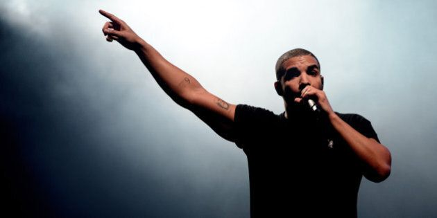FILE - In this June 27, 2015, file photo, Canadian singer Drake performs at the Wireless festival in Finsbury Park, in London. Drake has broken his silence on a deadly shooting at an after-party for his music festival at a downtown Toronto nightclub Aug. 4. (Photo by Jonathan Short/Invision/AP, File)