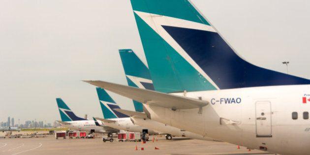 TORONTO, ONTARIO, CANADA - 2014/06/23: Westjet plane tails in Pearson International Airport. Westjet...