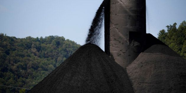 Coal spills out from a tower into a large pile at an Alpha Natural Resources Inc. coal preparation plant...
