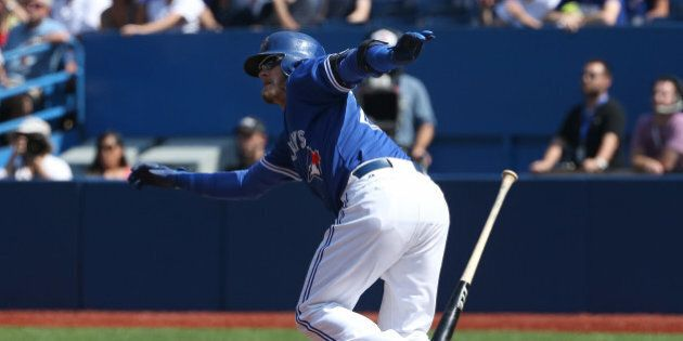 TORONTO, CANADA - SEPTEMBER 6: Josh Donaldson #20 of the Toronto Blue Jays hits an RBI double in the first inning during MLB game action against the Baltimore Orioles on September 6, 2015 at Rogers Centre in Toronto, Ontario, Canada. (Photo by Tom Szczerbowski/Getty Images)