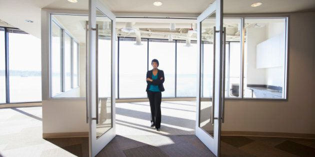 African American businesswoman standing in empty