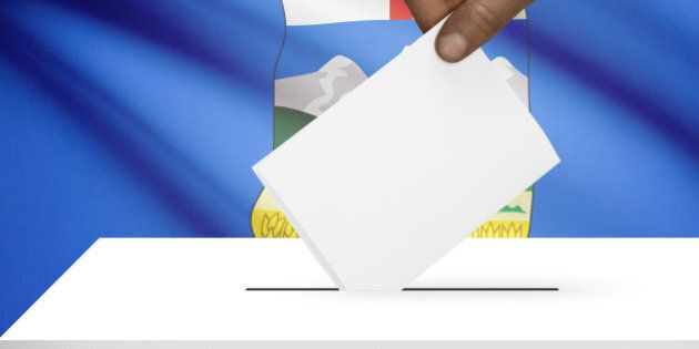 Ballot box with Canadian province flag on background -