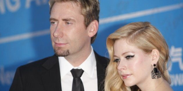 MACAU - OCTOBER 07: (CHINA OUT) Singer Avril Lavigne and her husband Chad Kroeger attend the 2013 Huading...
