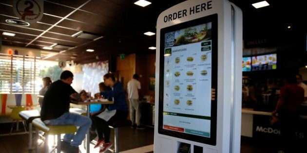 A self-service card payment touch screen panel displays sandwich options inside a McDonald's Corp. restaurant...