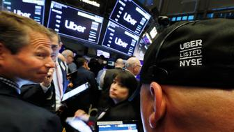Stock traders wait for the open of trading of Uber shares at the New York Stock Exchange, as the company makes its initial public offering, Friday, May 10, 2019. (AP Photo/Richard Drew)