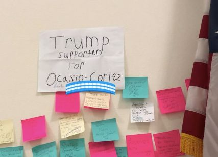 "Rep. Alexandria Ocasio-Cortez said she was ""astonished"" when a man and his son, who identified as Trump supporters, showed up at her office with a sign of support."