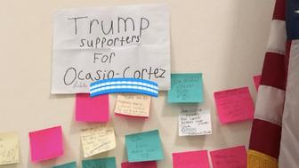 """Rep. Alexandria Ocasio-Cortez said she was """"astonished"""" when a man and his son, who identified as Trump supporters, showed up at her office with a sign of support."""