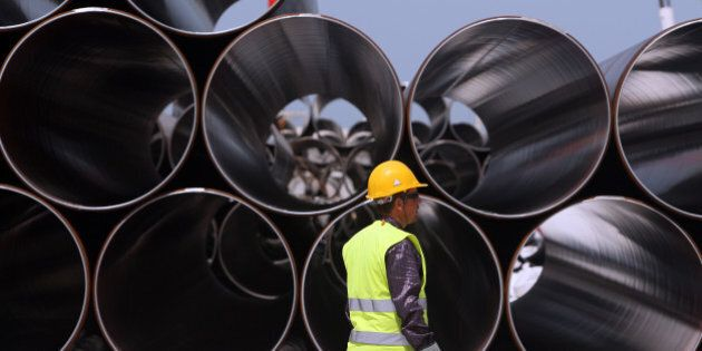 Some of the first pipes to arrive for the Trans-Adriatic Pipeline (TAP) project in Durres, Albania, Monday, April 18, 2016. Albania is part of the 878-kilometer (545 miles) TAP project that will bring gas from the Shah Deniz II field in Azerbaijan, across Turkey, Greece, Albania and undersea into southern Italy. (AP Photo/Hektor Pustina)