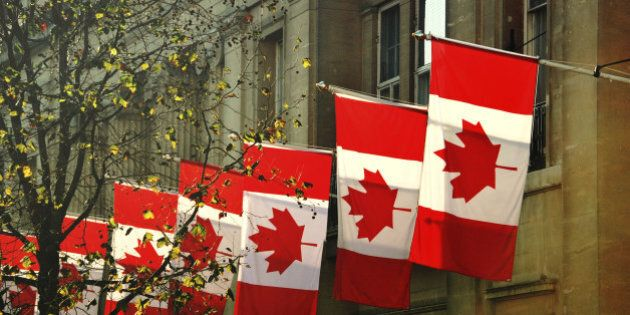 a row of Canadian flags outside Canada House in Trafalgar Square,