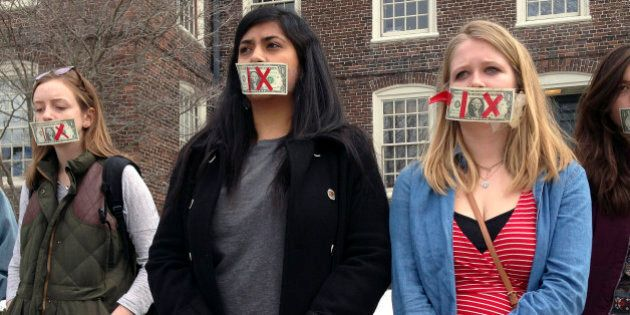 Brown University senior Maahika Srinivasan, center, of New Delhi, India, stands with senior Jeanette...