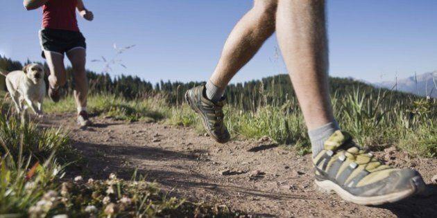 People running along path on hillside