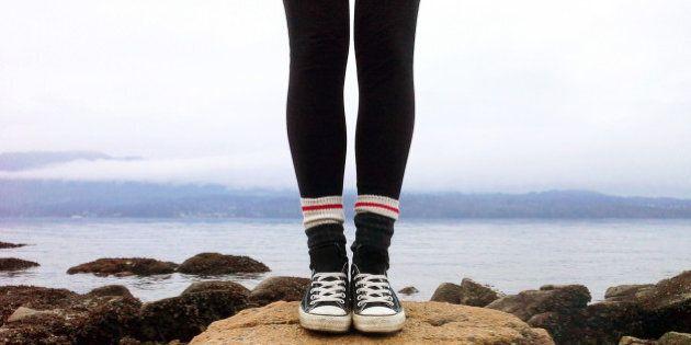 Teenage girl standing along the