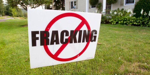 An anti-hydrofracking sign stands near the Ommegang Brewery in Cooperstown, New York, U.S., on Tuesday,...
