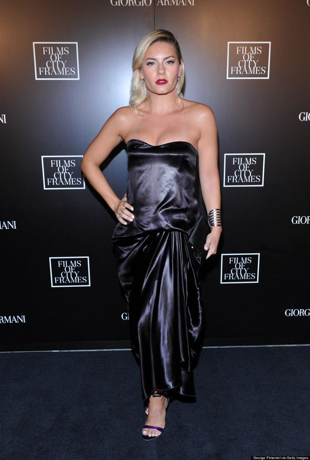 Elisha Cuthbert Takes The CN Tower Elevator To TIFF 2014