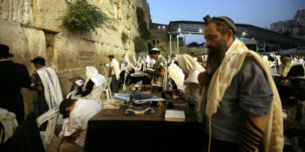 JERUSALEM, ISREAL - SEPTEMBER 2: Jews praying in front of the Wailing Wall on September 2, 2013 in Jerusalem....