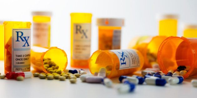 Prescription bottles and pills on a