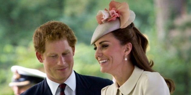 Britain's Prince Harry, left, speaks with Kate, the Duchess of Cambridge as they arrive for a commemoration...