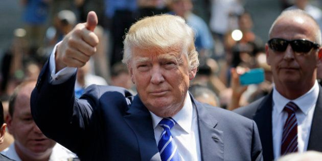 Donald Trump gives a thumbs-up as he leaves for lunch after being summoned for jury duty in New York,...