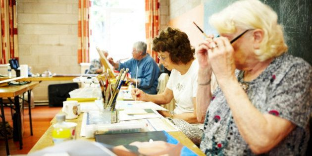 Image of senior women learning to paint in an art