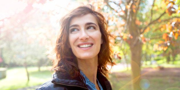 Girl smiling in autumn sun