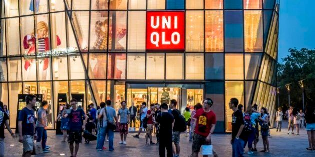BEIJING, CHINA - JULY 15: (CHINA OUT) People walk by a Uniqlo outlet at Sanlitun after a sex video taken...