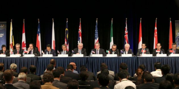 Ministers from 12 nations from left, Lim Jock Hoi from Brunei Darussalam, Ed Fast from Canada, Andres...
