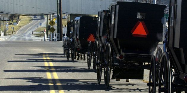It was slow going for Old Order Mennonite carriages returning from church Sunday, Jan. 12, 2003, in Dayton,...