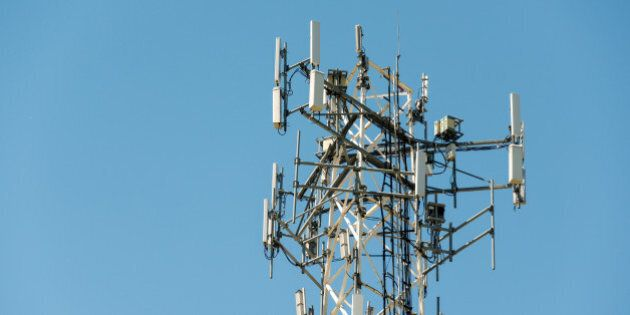 TORONTO, ONTARIO, CANADA - 2015/05/20: Top part of cell phone communication tower with multiple antennas...