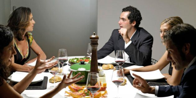 Group of people gathered around dinner table