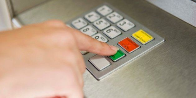 Person pushing buttons of ATM