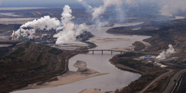 Aerial view of the Suncor oil sands extraction facility on the banks of the Athabasca River and near the town of Fort McMurray in Alberta Province, Canada on October 23, 2009.  Greenpeace is calling for an end to oil sands mining in the region due to their greenhouse gas emissions and have recently staged sit-ins which briefly halted production at several mines. At an estimated 175 billion barrels, Alberta's oil sands are the second largest oil reserve in the world behind Saudi Arabia, but they were neglected for years, except by local companies, because of high extraction costs. Since 2000, skyrocketing crude oil prices and improved extraction methods have made exploitation more economical, and have lured several multinational oil companies to mine the sands.            AFP PHOTO/Mark RALSTON (Photo credit should read MARK RALSTON/AFP/Getty Images)