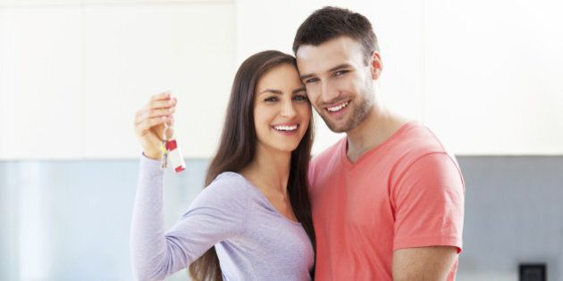 Couple with keys to new